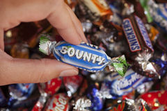 Bounty candy in woman's hand Stock Photo