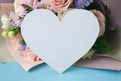Bouqet Flower background, different roses and chrysanthemum. Heart frame from Bouqet, Flower background, different roses, chrysanthemum, lisianthus on blue stock image
