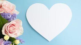 Bouqet Flower background, different roses and chrysanthemum. Heart frame from Bouqet, Flower background, different roses, chrysanthemum, lisianthus on blue stock images