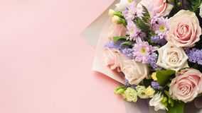 Bouqet Flower background, different roses and chrysanthemum. Bouqet, Flower background, different roses chrysanthemum lisianthus on pink background royalty free stock image