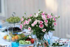 Bouqet of roses. Gift bouqet of beautiful flowers on the holiday table royalty free stock image