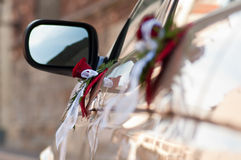 Bouqets on cars side doors. Focus on distal bouqet Royalty Free Stock Image