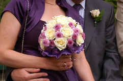Bouquet. Bride Holding Bouquet from rose - pinkly yellow Royalty Free Stock Images
