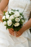 Bouquet. Bride holding a white roses bouquet Royalty Free Stock Photo