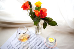 The bouquet. Bouquet of beautiful rose with musical notes and brandy glass Stock Image