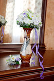 Bouquet. Bridal bouquet and boutonniere in a vase on the table Royalty Free Stock Photography