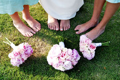 Bouquet. The bride and brides maids bouquet's on the grass at thier feet Stock Photography