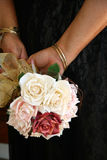 Bouquet. A bridesmaids bouquet and a back view of her dress Royalty Free Stock Image