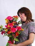 Bouquet. A woman receives a bouquet of flowers Royalty Free Stock Photos