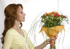 Bouquet. Pretty woman with bright nosegay royalty free stock image