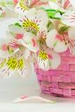 Bouquet of alstroemeria  in wicker basket Royalty Free Stock Photos