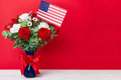Bouquet with american flag on red background Royalty Free Stock Photography