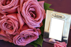 Bouquet And Picture Frame Stock Photo