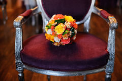 Bouquet  on an antique armcahair Stock Photos