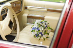 Bouquet on Armrest in Car Royalty Free Stock Photo