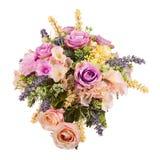 Bouquet from artificial flowers arrangement centerpiece in vase. Stock Photography