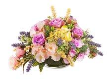 Bouquet from artificial flowers arrangement centerpiece in vase. Stock Images