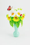 Bouquet from artificial flowers and sweets Royalty Free Stock Photo