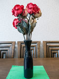 Bouquet of artificial red rose flower in vase Royalty Free Stock Images