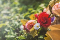 Bouquet of artificial roses. In the park Stock Image