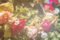 Bouquet of artificial roses. In the park Stock Images