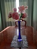 bouquet of artificial roses in a vase royalty free stock image