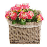 Bouquet from artificial roses  in wicker basket isolated on whit Royalty Free Stock Image
