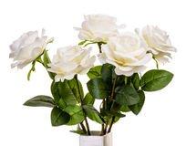 Bouquet of artificial white roses isolated. Bouquet of artificial white roses isolated on the white background Stock Images