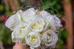 Bouquet of artificial white roses with pearls Stock Photo