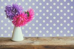 Bouquet aster flowers on wooden table Royalty Free Stock Image