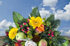 Bouquet with autumn decoration wooden table and blue sky Royalty Free Stock Image