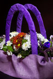 Bouquet of autumn flowers in a basket of lilac color. Stock Images