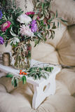 Bouquet of autumn flowers and berries on a wooden tray Royalty Free Stock Photo