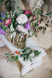 Bouquet of autumn flowers and berries on a wooden tray Royalty Free Stock Photos