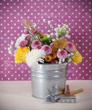 Bouquet of autumn flowers in the iron pot Stock Photos