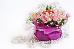Bouquet in basket and perl Royalty Free Stock Image