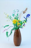 Bouquet of bead flowers. In earthenware vase royalty free stock photography