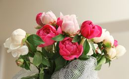 Bouquet of beautiful colorful peony flowers on blurred background. Closeup Royalty Free Stock Images