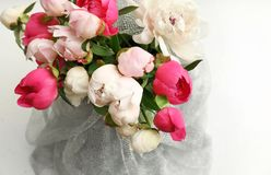 Bouquet of beautiful colorful peony flowers. On light table, closeup Royalty Free Stock Photography