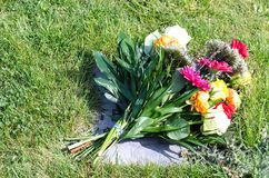 Bouquet. Beautiful bouquet of flowers on a grave stone Royalty Free Stock Photo