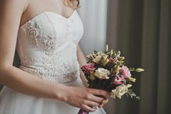 Bouquet of beautiful flowers in hands of the girl 2747. Royalty Free Stock Photography