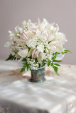 Bouquet of beautiful flowers in vase. Morning sunlight lights it up Royalty Free Stock Photography