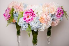 Bouquet of beautiful mixed flowers in vase. Lovely bunch of flowers. Work of the professional florist. Wedding or home decor.  stock photography