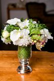 Bouquet of beautiful mixed flowers in vase. Lovely bunch of flowers. Work of the professional florist. Wedding or home decor.  stock images