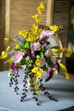 Bouquet of beautiful mixed flowers in vase on a table. Lovely bunch of flowers. Work of the professional florist. Wedding or home royalty free stock photo
