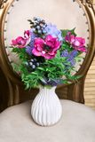Bouquet of beautiful mixed flowers in white vase. Lovely bunch of flowers. Work of the professional florist. Wedding or home decor stock images