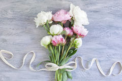 Bouquet of beautiful peonies. With vintage ribbon Royalty Free Stock Photography