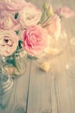 Bouquet of beautiful pink flowers on old wooden texture Royalty Free Stock Image