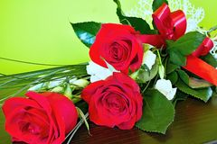 Bouquet of beautiful red roses. Bouquet of beautiful red roses lying on a table Royalty Free Stock Photography