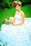 Bouquet. Beautiful smiling bride with chaming red hair. Wedding dress and accessories. Wedding decoration Stock Image